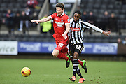Leyton Orient defender Shaun Brisley battles with Notts County striker Jason Banton during the Sky Bet League 2 match between Notts County and Leyton Orient at Meadow Lane, Nottingham, England on 20 February 2016. Photo by Jon Hobley.