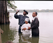 Traditional African american baptisms at Moon Lake Mississippi. <br />