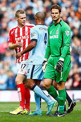 Ryan Shawcross of Stoke and Vincent Kompany of Manchester City tussle - Photo mandatory by-line: Rogan Thomson/JMP - 07966 386802 - 30/08/2014 - SPORT - FOOTBALL - Manchester, England - Etihad Stadium - Manchester City v Stoke City - Barclays Premier League.