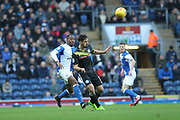 Jordan Williams clears under pressure from Elliott Bennett during the EFL Sky Bet League 1 match between Blackburn Rovers and Rochdale at Ewood Park, Blackburn, England on 26 December 2017. Photo by Daniel Youngs.