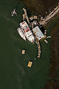 Aerial view of a shrimp boat docked along the marsh in Charleston, SC.