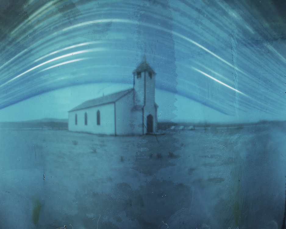 A 6 month long exposure of McDougal Church in Morley. From winter solstice (lowest arc in the sky) till summer solstice (highest arc). Made with a DIY pinhole camera and a piece of photographic paper.