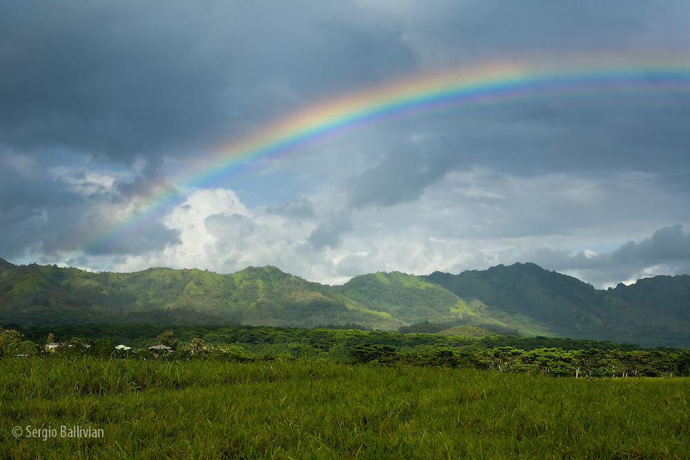 A rainbow appears above Hanalei Bay in Kauai, Hawaii after  a rainshower.