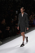 A men's short outfit wit black and gray shorts and matching double-breasted, unconstructed jacket by Richard Chai at the Spring 2013 Mercedes Benz Fashion Week show in New York.