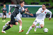 Melbourne City midfielder Lachlan Wales (19) runs pass Western Sydney Wanderers defender Raul Llorente (24) at the FFA Cup quarter-final soccer match between Melbourne City FC and Western Sydney Wanderers FC at AAMI Park in Melbourne.