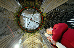 Licensed to London News Pictures 25/11/2016<br /> The advent wreath is suspended beneath the centarl tower of York Minster today.  Measuring 4m in diameter it's believed to be the largest suspended wreath in any church or cathedral in the UK - and possibly the world.  The five candles weighing 4kg's each are lit each Sunday of Advent beginning on Sunday 27 November.  The fifth candle is lit on Christmas Day.  The tradition of advent wreaths dates back to the Middle Ages.  Pictured is Minster School pupil Arthur Gameson aged 7, with a candle.   Photo Credit: Sam Atkins/LNP
