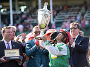 Jockey Javier Castellano celebrates after riding Cathryn Sophia to win the Longines Kentucky Oaks, Friday, May 6, 2016, in Louisville, Ky.   Longines, the Swiss watch manufacturer known for its luxury timepieces, is the Official Watch and Timekeeper of the 142nd annual Kentucky Derby. (Photo by Diane Bondareff/AP Images for Longines)