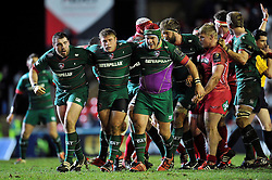 The Leicester Tigers front row look on after a strong scrum results in a penalty - Photo mandatory by-line: Patrick Khachfe/JMP - Mobile: 07966 386802 16/01/2015 - SPORT - RUGBY UNION - Leicester - Welford Road - Leicester Tigers v Scarlets - European Rugby Champions Cup