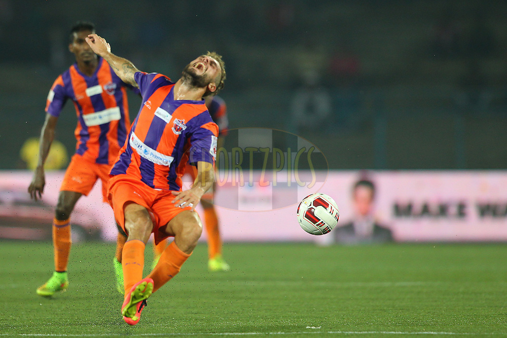Davide Colomba of FC Pune City grimaces after a tackle during match 24 of the Hero Indian Super League between Atl&eacute;tico de Kolkata and FC Pune City held at the Salt Lake Stadium in Kolkata, West Bengal, India on the 7th November 2014.<br /> <br /> Photo by:  Ron Gaunt/ ISL/ SPORTZPICS