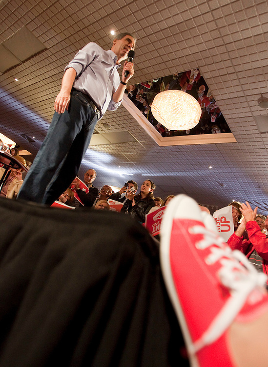 Liberal leader Michael Ignatieff  is seen at a rally in Kitchener, Ontario next to his wife Zsuzsanna Zsohar's new red converse shoes which they unveiled today for the last days of the campaign Friday April 29, 2011.<br /> REUTERS/Geoff Robins (CANADA)