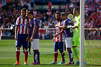Atletico de Madrid´s MArio Suarez and Arda Turan and Espanyol´s Salva and goalkeeper Casilla during 2014-15 La Liga Atletico de Madrid V Espanyol match at Vicente Calderon stadium in Madrid, Spain. October 19, 2014. (ALTERPHOTOS/Victor Blanco)