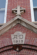 The stonework above the main entrance of the Holy Childhood of Jesus School building in Harbor Springs, Michigan.