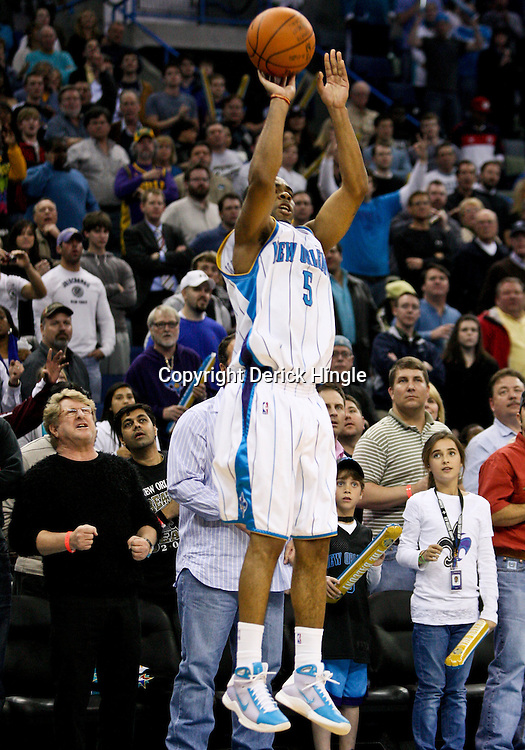 Feb 26, 2010; New Orleans, LA, USA; New Orleans Hornets guard Marcus Thornton (5) shoots a three pointer against the Orlando Magic during the fourth quarter at the New Orleans Arena. The Hornets defeated the Magic 100-93. Mandatory Credit: Derick E. Hingle-US PRESSWIRE