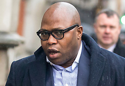 © Licensed to London News Pictures. 15/01/2018. London, UK. Lanre Haastrup, the father of nine-month-old Isaiah Haastrup arrives at the High Court. The family of Isaiah are fighting for further treatment of their son, who cannot breathe for himself and has cerebal palsy following birth complications at Kings College Hospital. Mr Haastrup was banned from the hospital in November last year, following an incident. Photo credit : Tom Nicholson/LNP