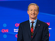 "14 JANUARY 2020 - DES MOINES, IOWA: TOM STEYER on stage during the ""photo spray"" at the CNN Democratic Presidential Debate on the campus of Drake University in Des Moines. This is the last debate before the Iowa Caucuses on Feb. 3.    PHOTO BY JACK KURTZ"