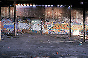 brick wall with graffiti in abandoned building