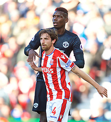 STOKE-ON-TRENT, ENGLAND - Saturday, September 9, 2017: Stoke City's legendary Wales midfielder Joe Allen and Manchester United's Paul Pogba during the FA Premier League match between Stoke City and Manchester United at the Bet365 Stadium. (Pic by David Rawcliffe/Propaganda)
