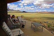 NAMIBIA, NAMIB DESERT..CC Africa Afro Venture's Sossusvlei Mountain Lodge. Susanne Schattka at the restaurant terrace..(Photo by Heimo Aga)