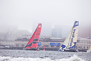 Puma nd Delta Lloyd sailng past the World Trade Center, Boston, at the start of the Volvo Ocean Race, Leg 7.