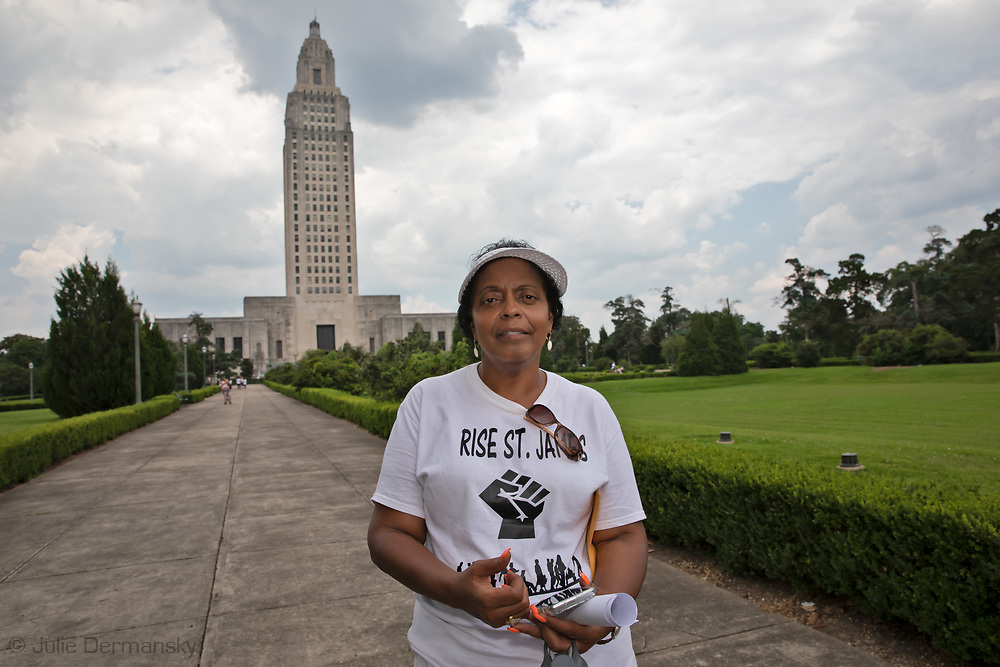 "Sharon Lavigne  in the  State Capitol in Baton Rouge  on the last  day of a five day march through Louisiana's 'Cancer Alley' held by the Coalition Against Death Alley . The Coalition Against Death Alley (CADA), is a group of Louisiana-based residents and members of various local and state organizations, is calling for a stop to the construction of new petrochemical plants and the passing of stricter regulations on existing industry in the area that include the groups RISE St. James, Justice and Beyond, the Louisiana Bucket Brigade, 350 New Orleans, and the Concerned Citizens of St. John.  Louisiana's Cancer Alley, an 80-mile stretch along the Mississippi River, is also known as the ""Petrochemical Corridor,"" where there are over 100 petrochemical plants and refineries."