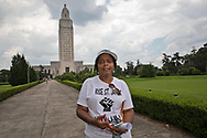 """Sharon Lavigne  in the  State Capitol in Baton Rouge  on the last  day of a five day march through Louisiana's 'Cancer Alley' held by the Coalition Against Death Alley . The Coalition Against Death Alley (CADA), is a group of Louisiana-based residents and members of various local and state organizations, is calling for a stop to the construction of new petrochemical plants and the passing of stricter regulations on existing industry in the area that include the groups RISE St. James, Justice and Beyond, the Louisiana Bucket Brigade, 350 New Orleans, and the Concerned Citizens of St. John.  Louisiana's Cancer Alley, an 80-mile stretch along the Mississippi River, is also known as the """"Petrochemical Corridor,"""" where there are over 100 petrochemical plants and refineries."""