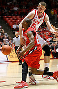 San Diego State guard D.J. Gay (23) is fouled by Utah center David Foster (51) during the second half of an NCAA college basketball game, Saturday, Jan. 8, 2011, in Salt Lake City, Utah. San Diego State defeated Utah 71-62. (AP Photo/Colin E Braley)
