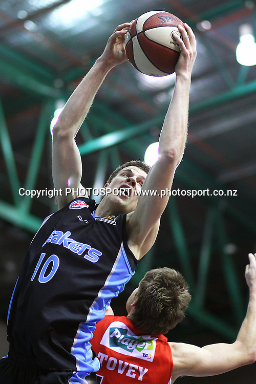 Breakers' Tom Abercrombie gets high for a rebound. iinet ANBL, New Zealand Breakers vs Perth Wildcats, North Shore Events Centre, Auckland, New Zealand. Wednesday 20th October 2010. Photo: Anthony Au-Yeung / photosport.co.nz