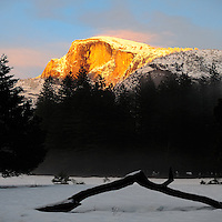 Half Dome at Sunset from Curry Village in Yosemite National Park. Image taken with a Nikon D3x and 50 mm f/1.4G lens (ISO 100, f/4, 1/250 sec)