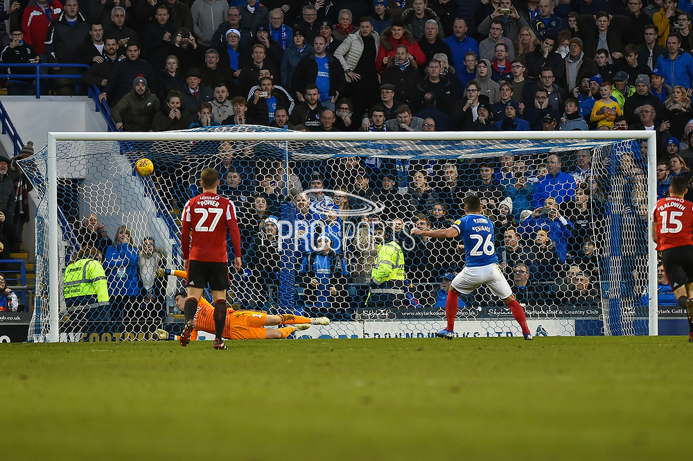 Portsmouth Midfielder, Gareth Evans (26) scores a penalty to make it 1-0 during the EFL Sky Bet League 1 match between Portsmouth and Sunderland at Fratton Park, Portsmouth, England on 22 December 2018.