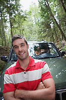 Man in front of car in forest portrait