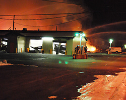 2/9/2011 Allentown, PA Emergency crews respond to a massive explosion Wednesday night in the area of 13th and Allen Street. Garage doors at a car wash across the street from the explosion were blown off their tracks. Express-Times Photo |CHRIS POST