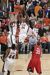 Virginia guard/forward Mamadi Diane (24) and Virginia forward Jamil Tucker (12) both dunk a pass from Virginia guard Sean Singletary (44).  The Virginia Cavaliers defeated the Maryland Terrapins 91-76 at the University of Virginia's John Paul Jones Arena  in Charlottesville, VA on March 9, 2008.