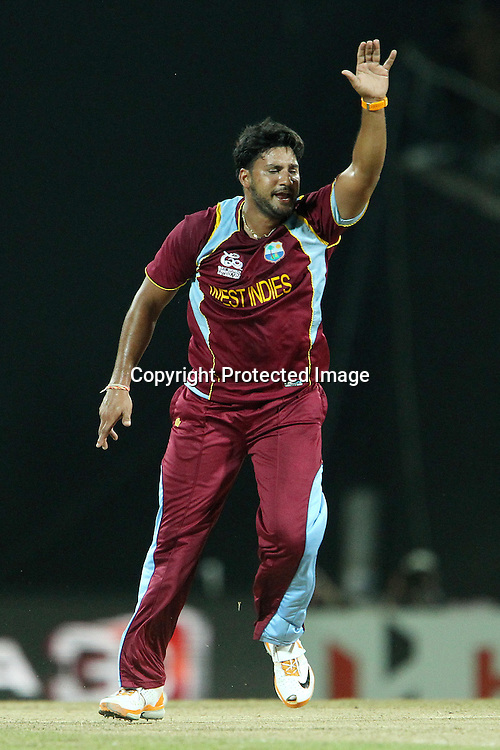 Ravi Rampaul of The West Indies appeals in vain for the wicket of Kumar Sangakkara during the ICC World Twenty20 Super 8s match between Sri Lanka and The West Indies held at the  Pallekele Stadium in Kandy, Sri Lanka on the 29th September 2012<br /> <br /> Photo by Ron Gaunt/SPORTZPICS