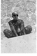 BILLY NORWICH, Cipriani swimming pool. Venice. 1991. <br /> <br /> SUPPLIED FOR ONE-TIME USE ONLY&gt; DO NOT ARCHIVE. &copy; Copyright Photograph by Dafydd Jones 248 Clapham Rd.  London SW90PZ Tel 020 7820 0771 www.dafjones.com