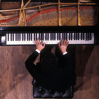 An overhead view of a pianist in performance with the Fairfax Symphony Orchestra in this undated photo.