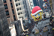 The Sponge Bob Square Pants balloon goes down 6th Avenue for the 89th annual Macy's Thanksgiving Day Parade as seen from above street level on Thursday, Nov. 26, 2015, in New York. (Photo by Ben Hider/Invision/AP)