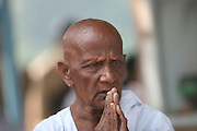 India, Devote man at pray