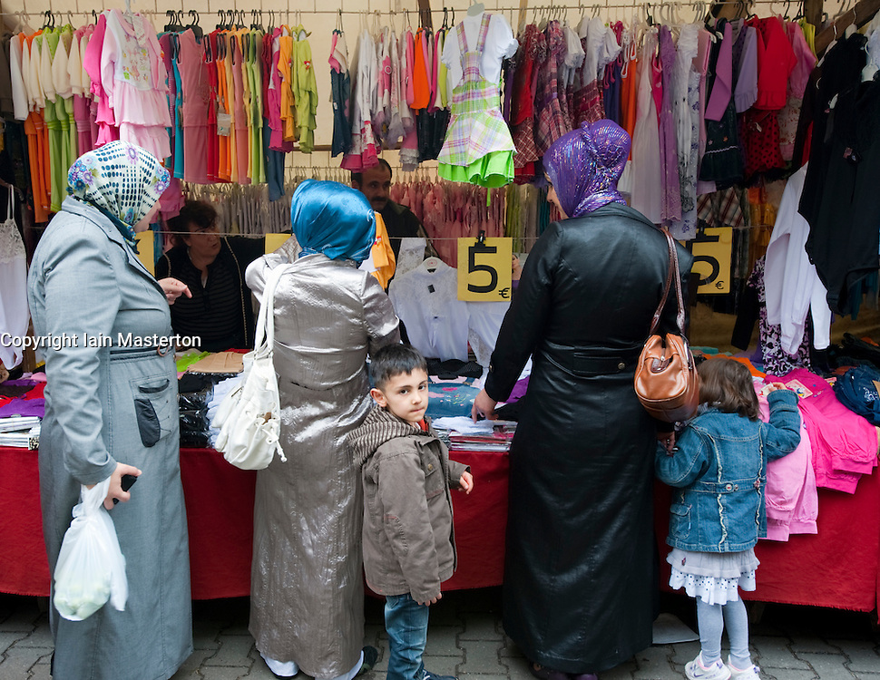 Turkish women buying headscarves at Turkish market on Maybachufer in Kreuzberg district of Berlin Germany