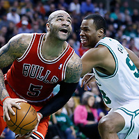 13 February 2013: Chicago Bulls power forward Carlos Boozer (5) drives past Boston Celtics center Jason Collins (98) during the Boston Celtics 71-69 victory over the Chicago Bulls at the TD Garden, Boston, Massachusetts, USA.