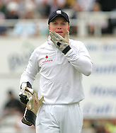 Photo © ANDREW FOSKER / SPORTZPICS 2008 - Wicketkeeper Tim Ambrose looks remarkably calm while holding his chin having been hit in the face while (not) stopping a Steve Harmison deivery  - England v South Africa - 07/08/08 - Fourth nPower Test Match -  Day 1 - The Brit Oval - London - UK - All rights reserved
