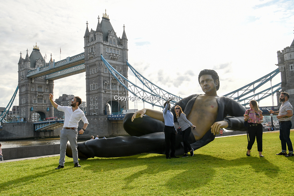 NOW TV unveil a jurassic-sized statue of Jeff Goldblum's glorious semi-naked torso in Potters Field on July 18 2018, London, UK.