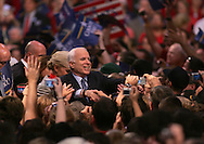 Senator John McCain shakes hands at a campaign rally in Virginia Beach, VA on October 13, 2008.  Photograph by Dennis Brack