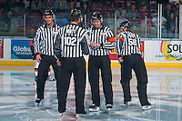 KELOWNA, CANADA - NOVEMBER 5: WHL referees Tyler Adair and Jeff Ingram stand at centre ice with linesmen Dustin Minty and Travis Gawryletz at the start of the game between Kelowna Rockets and Medicine Hat Tigers on November 5, 2016 at Prospera Place in Kelowna, British Columbia, Canada.  (Photo by Marissa Baecker/Shoot the Breeze)  *** Local Caption *** Tyler Adair; Jeff Ingram; Dustin Minty; Travis Gawryletz;