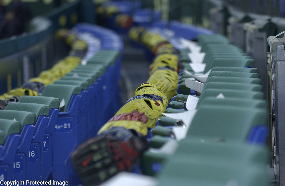 Baseball gloves are provided for the fans seating in the premium field level seats down the foul lines at Tokyo Dome, Tokyo, Japan.