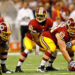 September 9, 2012; New Orleans, LA, USA; Washington Redskins quarterback Robert Griffin III (10) under center Will Montgomery (63) during the first half of a game against the New Orleans Saints at the Mercedes-Benz Superdome. Mandatory Credit: Derick E. Hingle-US PRESSWIRE