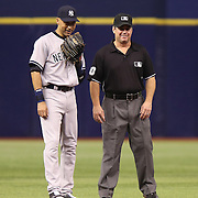 New York Yankees shortstop Derek Jeter (2) is seen talking with Umpire Rob Drake on the field during a major league baseball game between the New York Yankees and the Tampa Bay Rays at Tropicana Field on Thursday, Sept. 17, 2014 in St. Petersburg, Florida. The Yankees won the game 3-2 and this was Jeter's last game against Tampa Bay. (AP Photo/Alex Menendez)