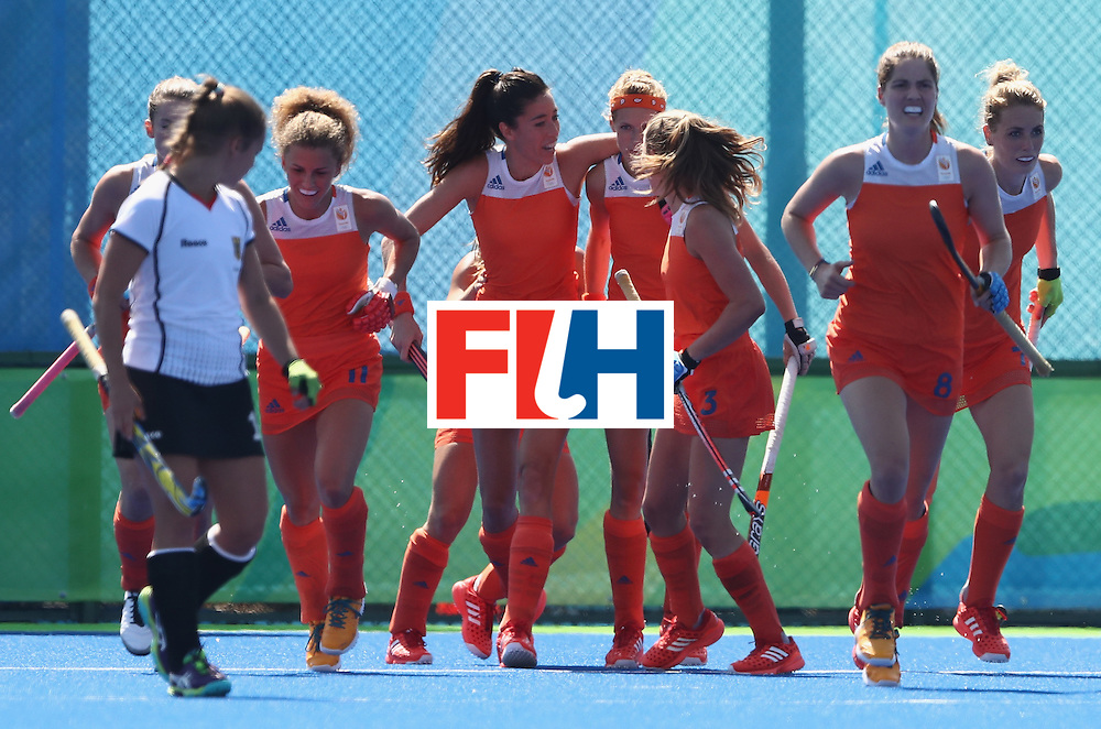 RIO DE JANEIRO, BRAZIL - AUGUST 13:  The Netherlands celebrate after Xan de Waard scores a goal during the Women's group A hockey match between the Netherlands and Germany on Day 8 of the Rio 2016 Olympic Games at the Olympic Hockey Centre on August 13, 2016 in Rio de Janeiro, Brazil.  (Photo by David Rogers/Getty Images)