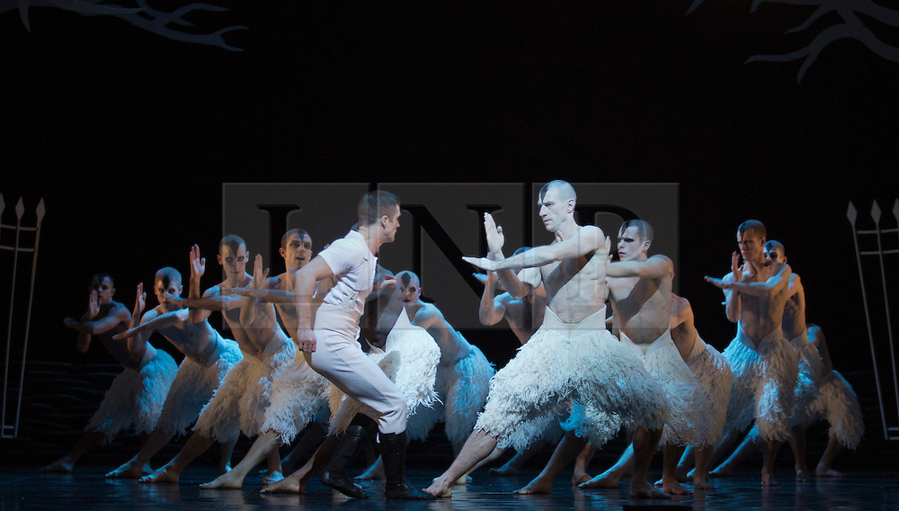 © Licensed to London News Pictures. 05/12/2013. London, England. With Jonathan Ollivier as The Swan and Simon Williams as The Prince. Matthew Bourne's Swan Lake is performed at Sadler's Wells Theatre from 4 December 2013 to 26 January 2014. Photo credit: Bettina Strenske/LNP