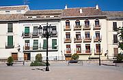 Historic whitewashed buildings Plaza de la Constitucion, Alhama de Granada, Spain