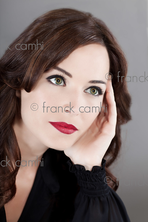 beautiful  caucasian woman portrait looking away thinking studio isolated background